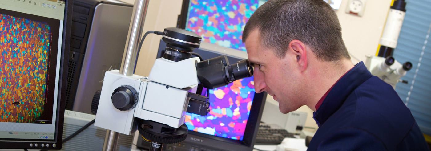 man looking into a microscopeman